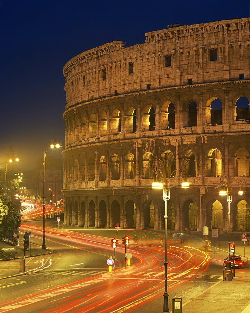 The Colosseum illuminated at night in Rome, Lazio, Italy, Europe