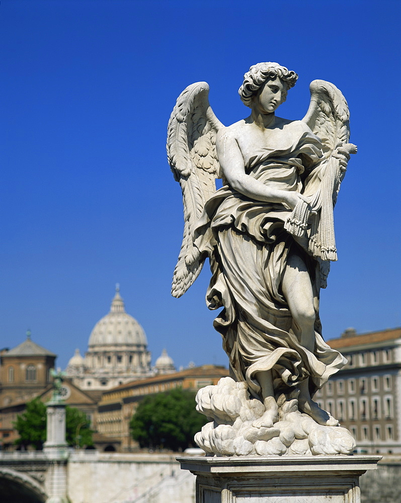Statue of an angel in front of the dome of St. Peters in Rome, Lazio, Italy, Europe