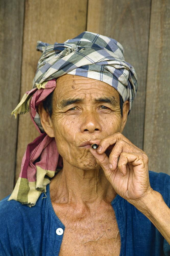 Portrait of refugee smoking, Shan Man Refugee Camp, Tak Maesot, Thailand, Southeast Asia, Asia