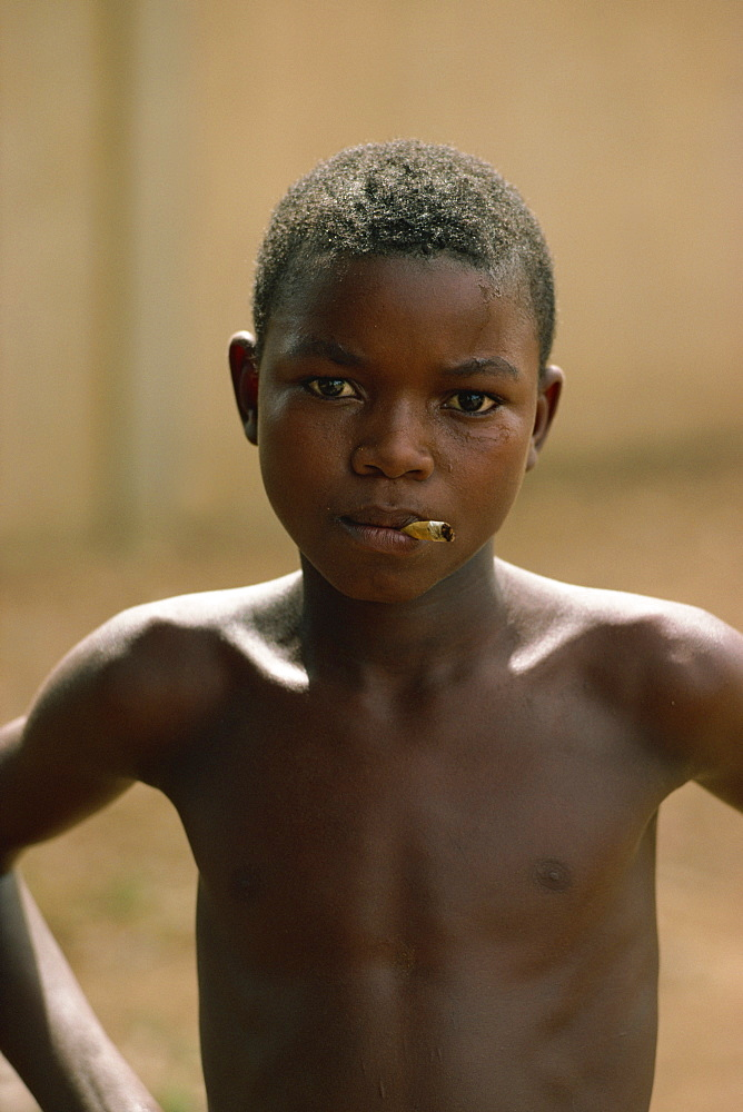 Boy with cigarette, Niamey, Niger, Africa