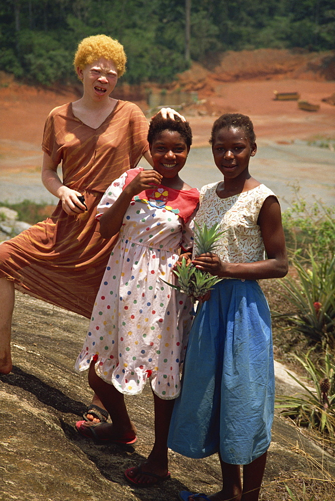 Three local girls, including albino girl, Sangmelima, Cameroon, West Africa, Africa