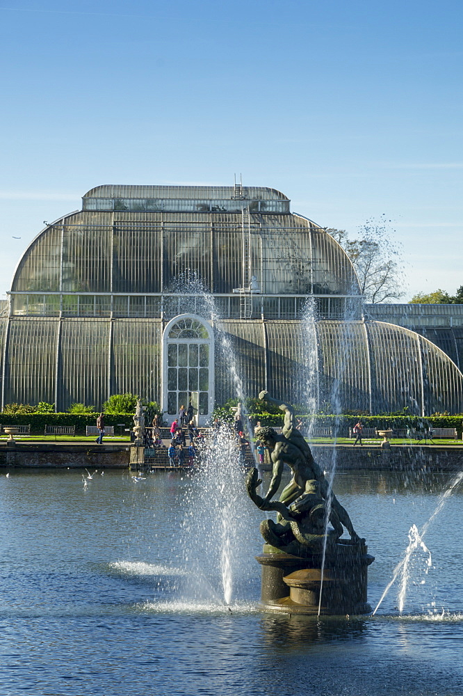 Hercules and Achelous statue stands in front of Kew Gardens Palm House, Royal Botanic Gardens, UNESCO World Heritage Site, Kew, London, England, United Kingdom, Europe