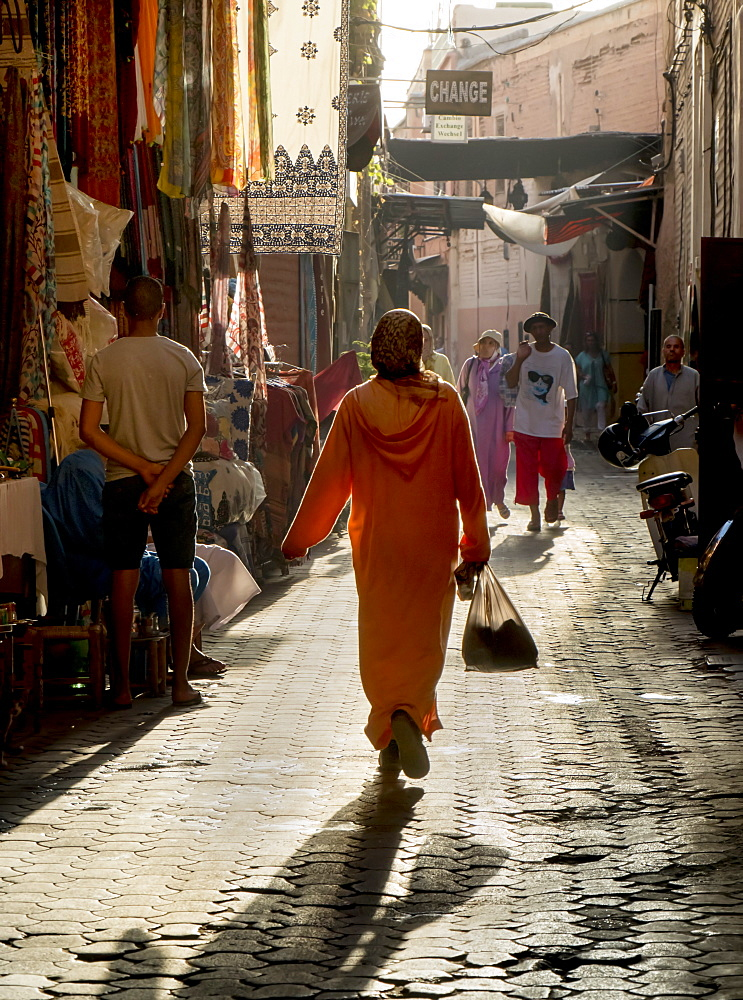 Woman in pink, Medina souk, Marrakech, Morocco, North Africa, Africa