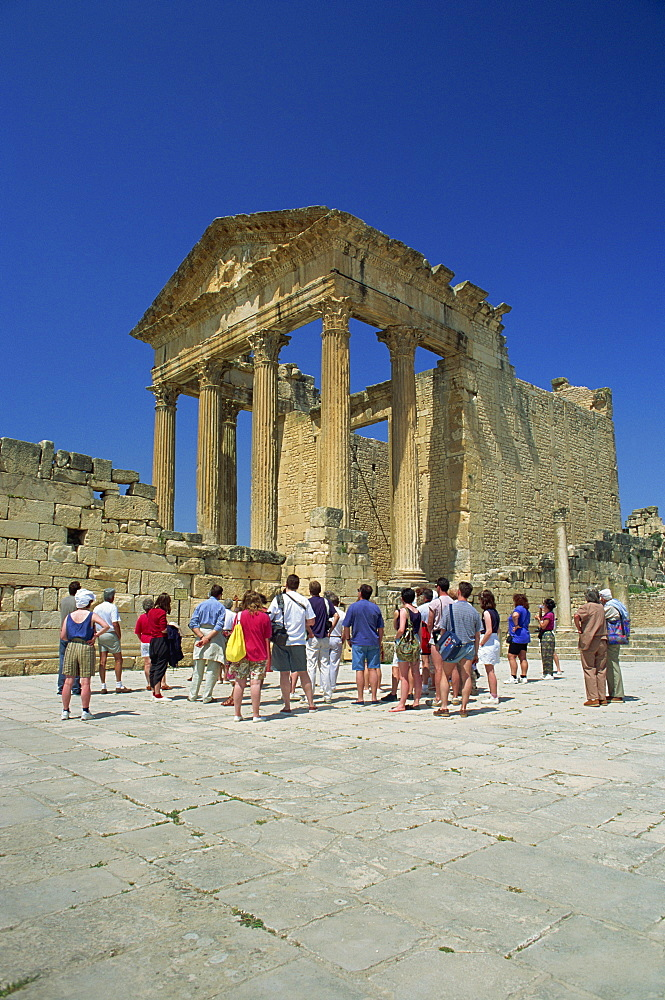 Tourists at the Roman ruins, the Capitol, Dougga, UNESCO World Heritage Site, Tunisia, North Africa, Africa - 382-436