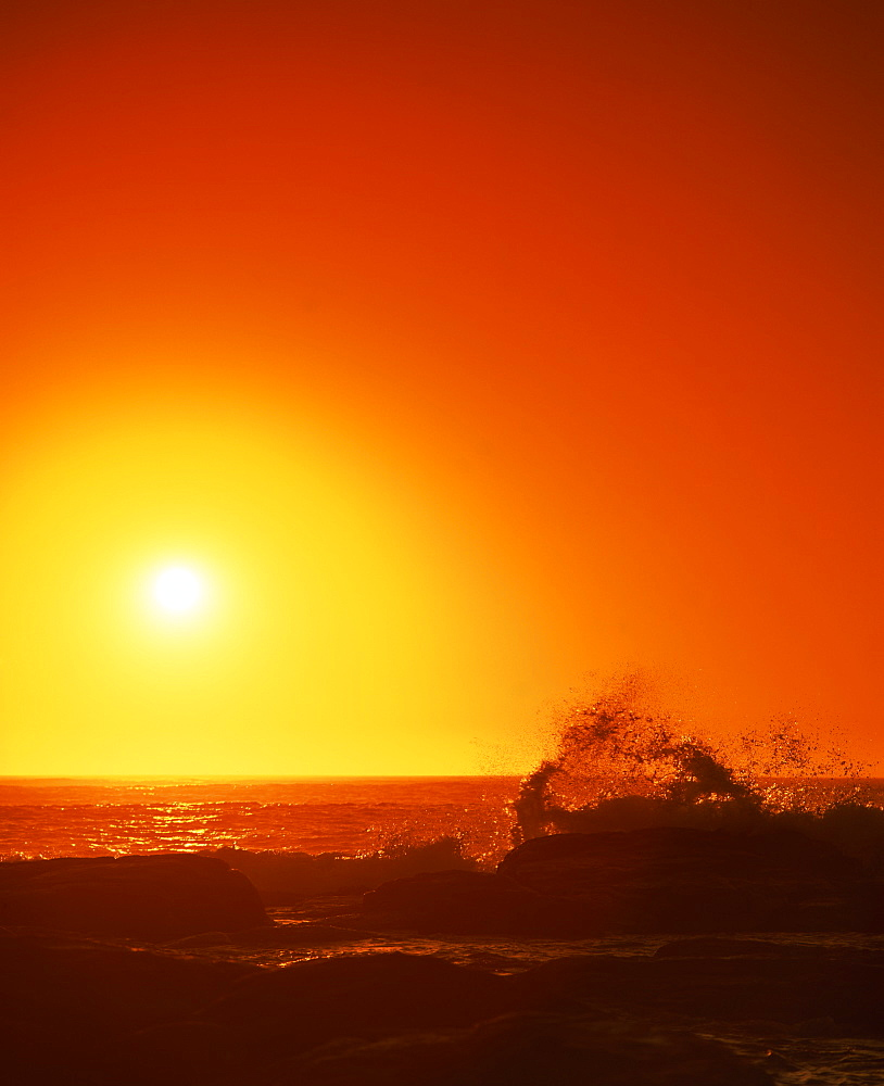 Sunset over the Indian Ocean, with waves breaking on coastline of Prevwlly, Western Australia, Australia, Pacific - 383-1274