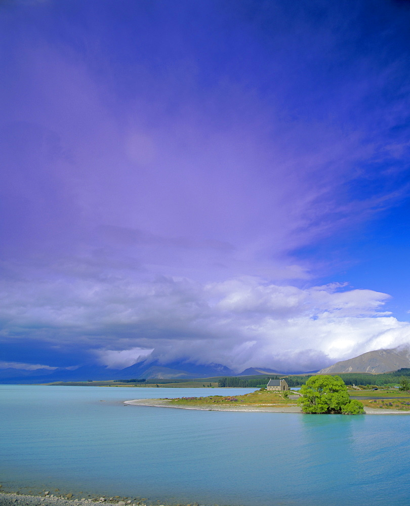 Storm approaching over Two Thumb Range, the Church of the Good Shepherd on the shore of Lake Tekapo, Canterbury District, South Island, New Zealand