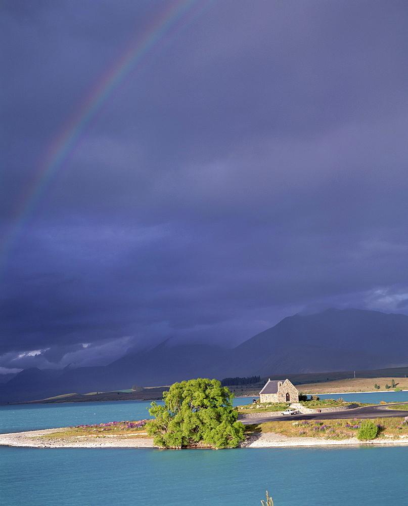 Rainbow and storm approaching, Christian Church of the Good Shepherd, Lake Tekapo, with Two Thumb Range beyond, Canterbury, South Island, New Zealand, Pacific