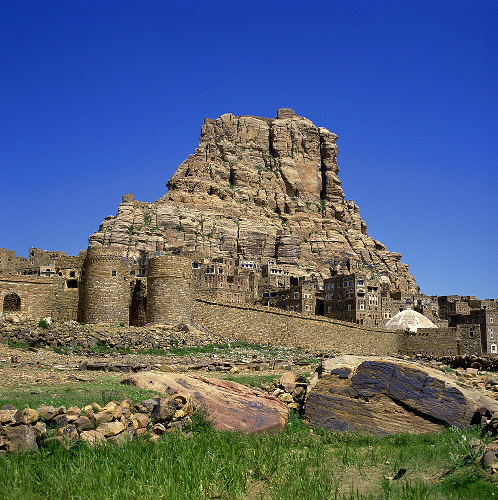 Walls and city below fortress on top of the mountain at Thulla, Yemen, Middle East