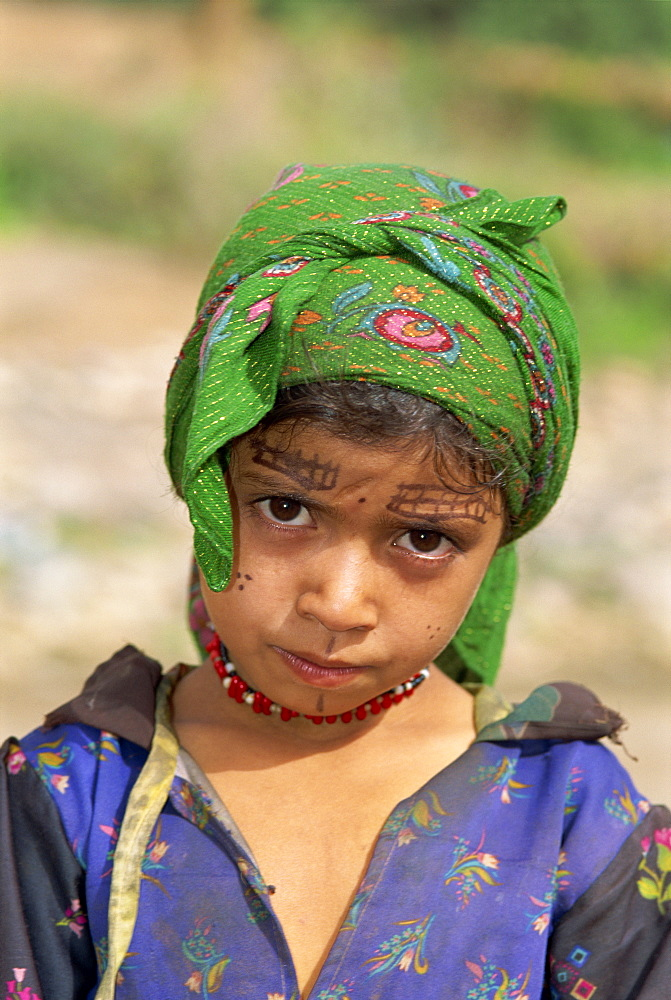 Portrait of a young girl with henna decoration on her face, Al Hajjera village, Haraz Mountains, north Yemen, Middle East