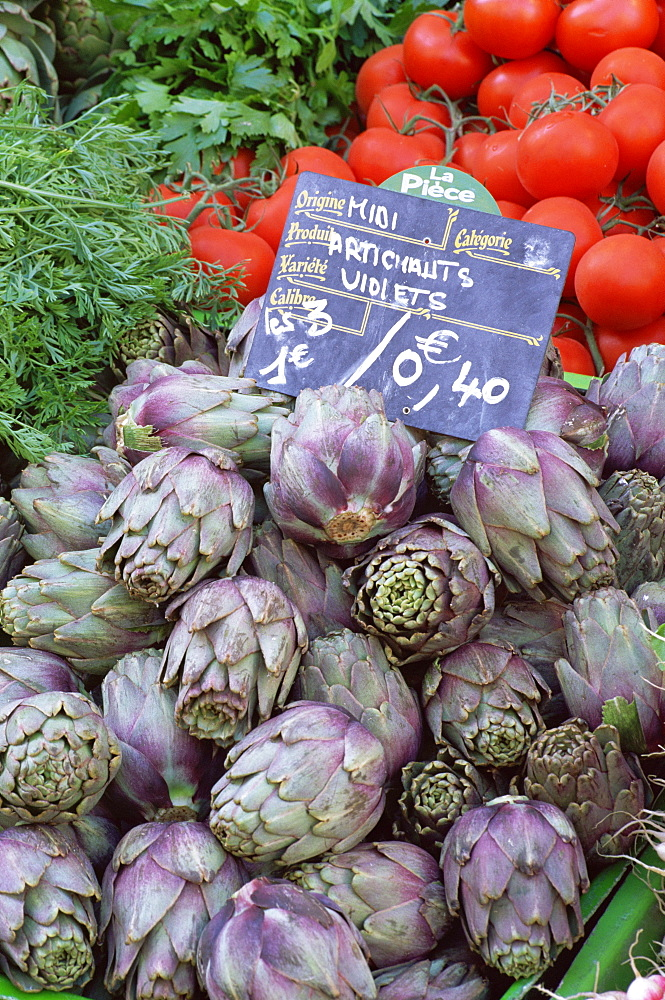 Artichokes for sale on market in the Rue Ste. Claire, Annecy, Haute Savoie, Rhone-Alpes, France, Europe - 390-2198