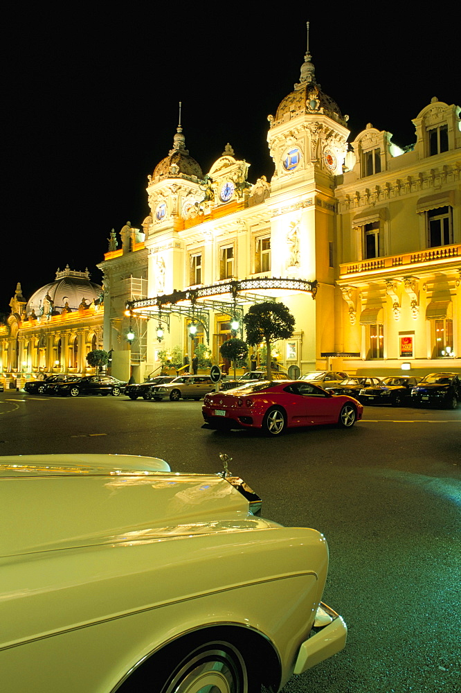 Rolls Royce and Ferrari parked in front of the Casino at night, Monte Carlo, Monaco, Mediterranean, Europe