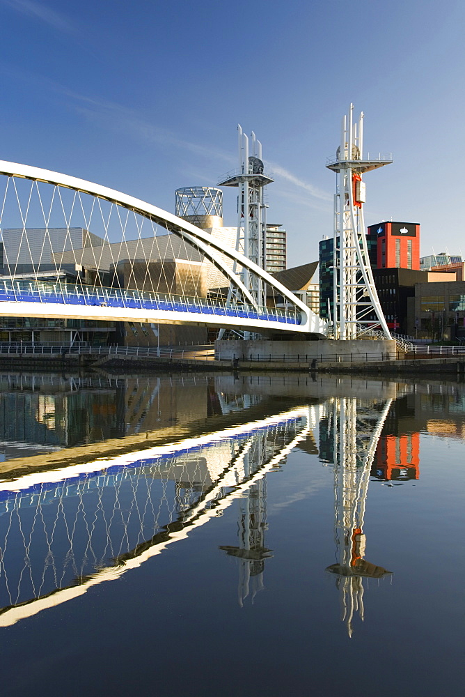 The Millennium Bridge reflected in the Manchester Ship Canal, Salford Quays, Salford, Greater Manchester, England, United Kingdom, Europe