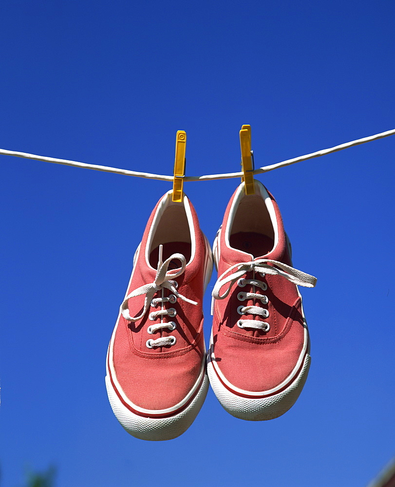 Pair of beach shoes on washing line