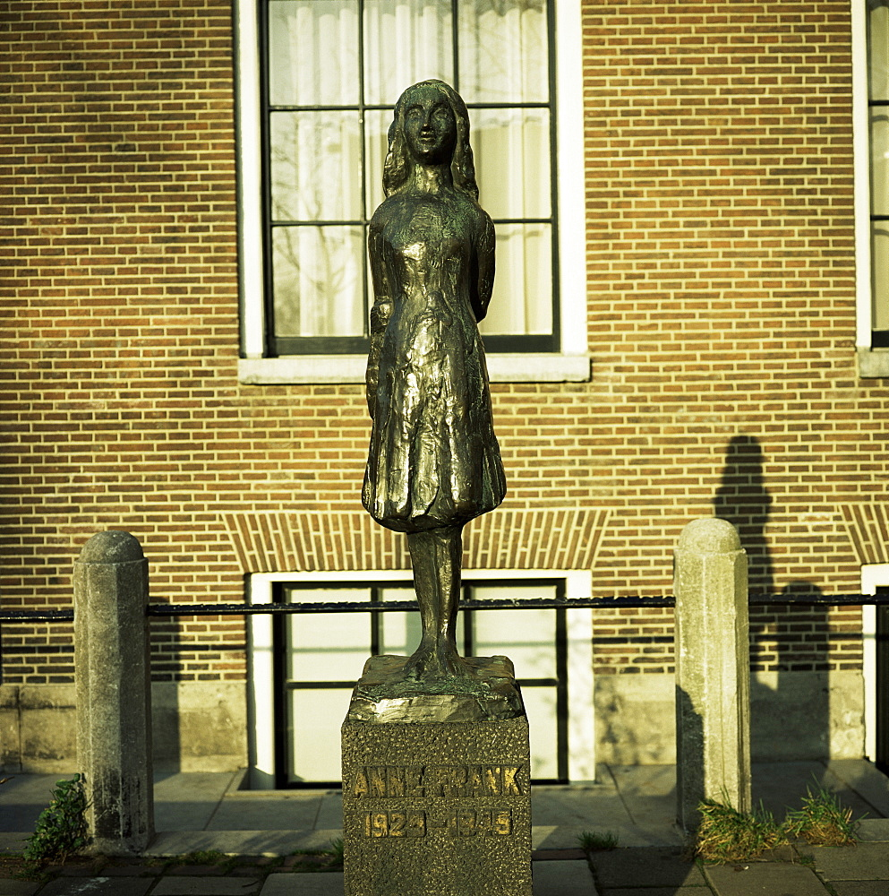 Statue of Anne Frank, the Jewish girl who wrote a diary whilst hiding from the Nazis during World War II, Amsterdam, Holland, Europe