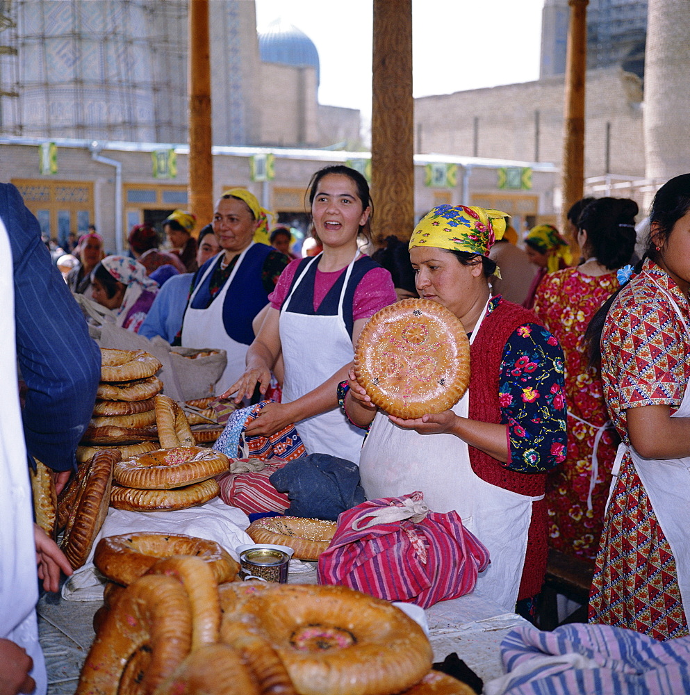 Women selling bread from stalls in the central market in the city of Samarkand, Uzbekistan, Central Asia, Asia