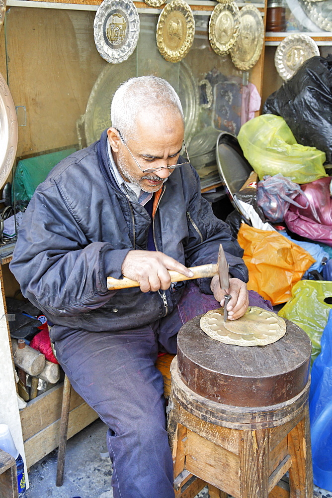 Copper worker in Copper Souq, Ghizdara Street, Tripoli, Libya, North Africa, Africa