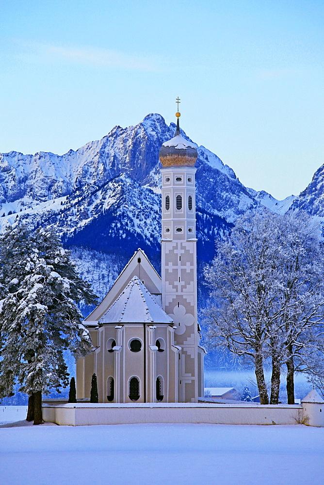 Church St. Coloman and Tannheimer Alps near Schwangau, Allgäu, Bavaria, Germany