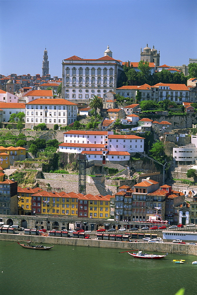 The Ribeira district on the waterfront of the Douro River, with the white facade of the Bishops Palace above, in the centre of Oporto, Portugal, Europe