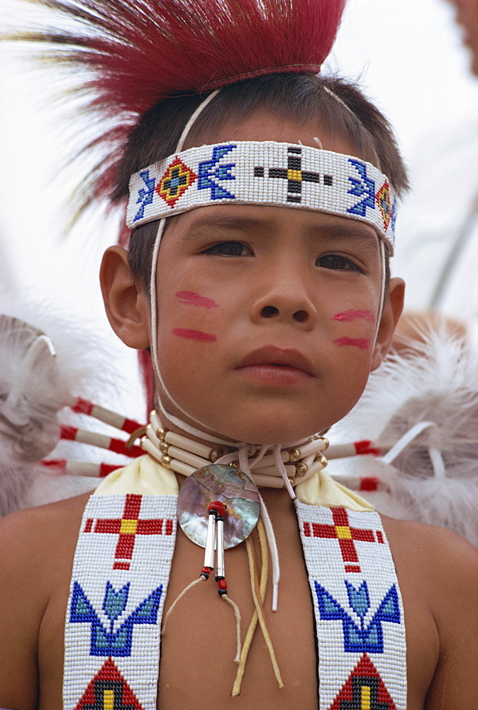 Portrait of young Crow indian boy in traditional costume, New Mexico, United States of America, North America