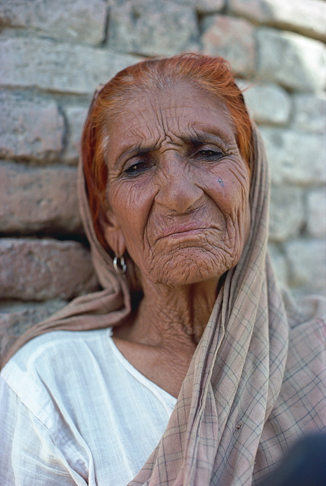 Portrait of an elderly woman with hair dyed red with henna, at Harappa, Punjab, Pakistan, Asia