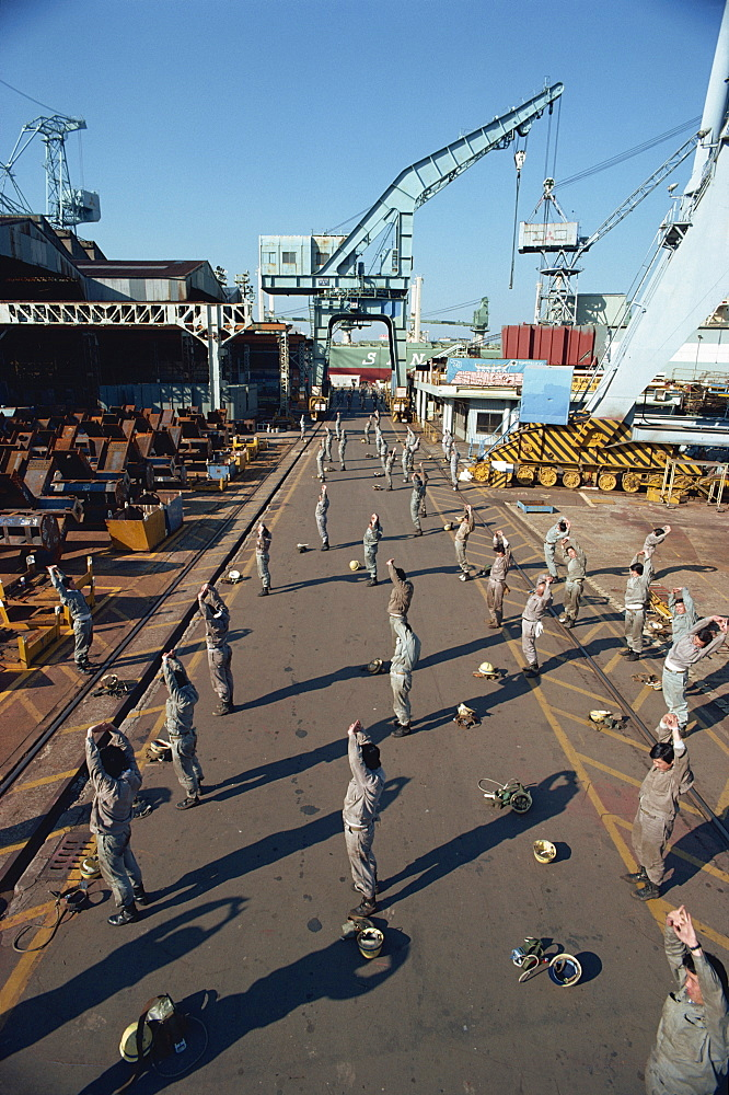 Workers stretching and exercising before work in the morning, Yokohama, Japan, Asia