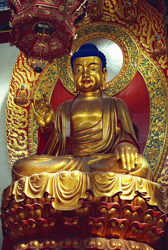 Statue of the Buddha in the main hall of the Ling Yinx Temple, dating from the Ming dynasty, but restored, at Hangchow, China, Asia