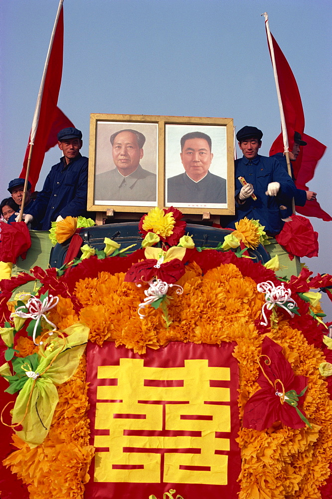 Photograph taken in the 1960s of a truck decorated with portraits of Hua Kuo-feng and Mao Tse Tung during festive parade, Beijing, China, Asia - 399-3865