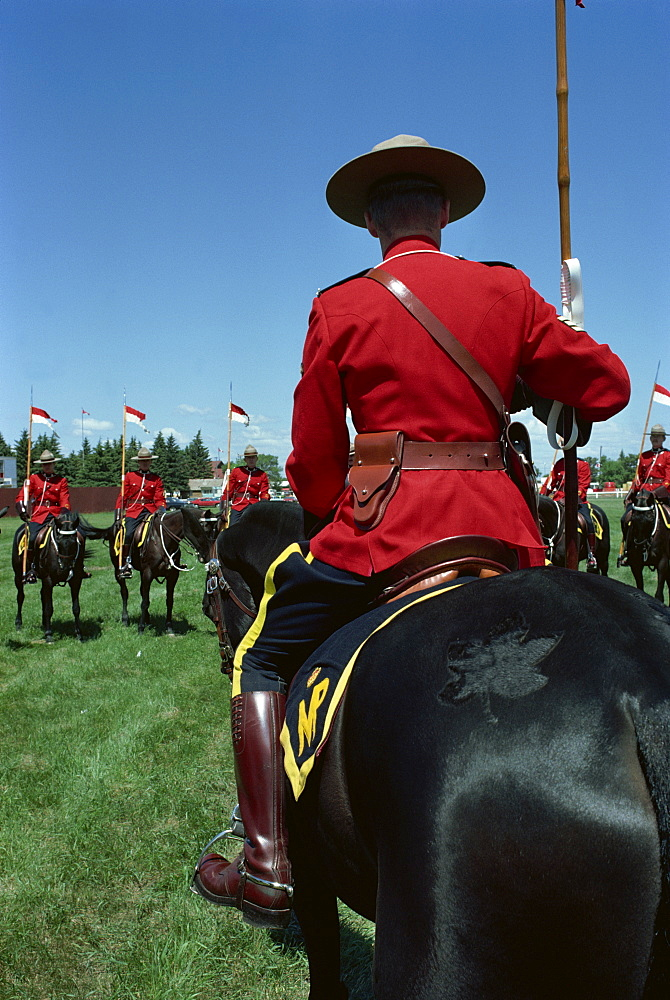 Mounties on horseback during roll call and instructions before performance of show number Musical Ride, at Regina, Saskatchewan, Canada, North America