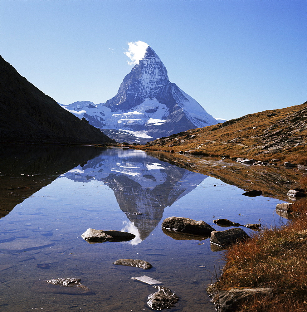 The Matterhorn, 4478m, from the east, over Riffel Lake, Swiss Alps, Switzerland, Europe