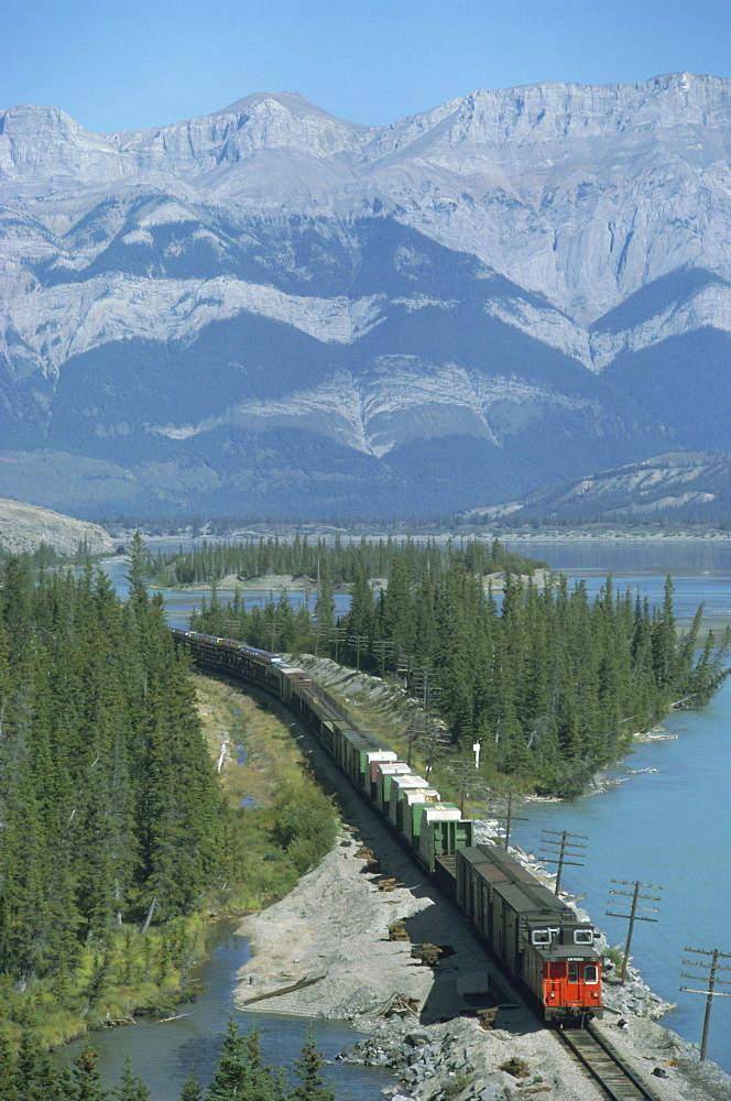 Canadian National Railways goods train along Athabasca River, Jasper National Park, UNESCO World Heritage Site, Alberta, Rocky Mountains, Canada, North America