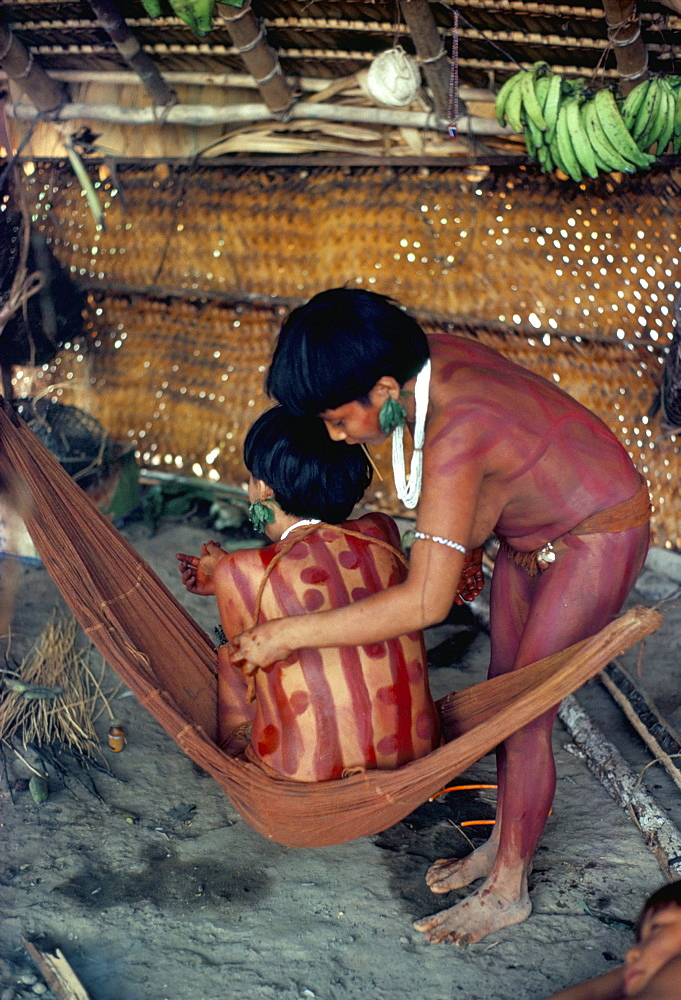 Yanomami girls applying body make-up, Brazil, South America
