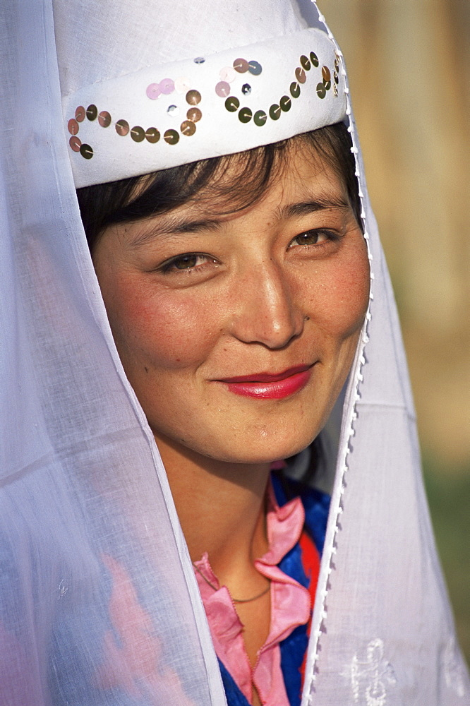 Portrait of a young woman in national dress, Otoraigur, near Balikchi, Kyrgyzstan, Central Asia, Asia