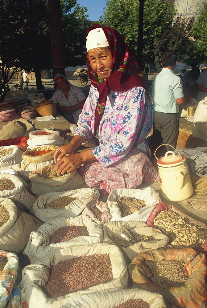 Herb seller in main food market, Samarkand, Uzbekistan, Central Asia, Asia