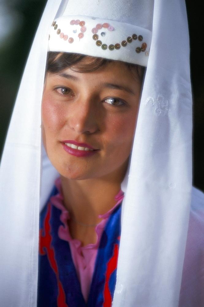 Otoraigur girl in national dress, near Balikchi, Kyrgyzstan, Central Asia, Asia