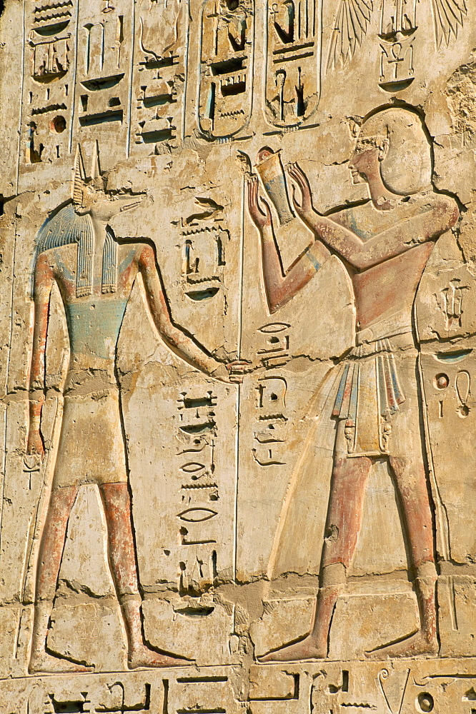Relief of the pharaoh Ramses III and the god Anubis, Medinet Habu, UNESCO World Heritage Site, West Bank, Thebes, Egypt, North Africa, Africa