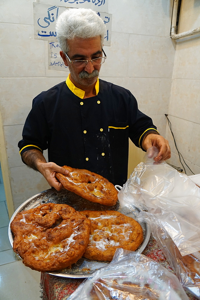 Traditional surouk (flat doughnuts) baker, Yazd, Iran, Middle East