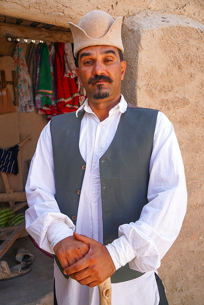 Iranian man posing as Qajar landlord, Varzaneh, Iran