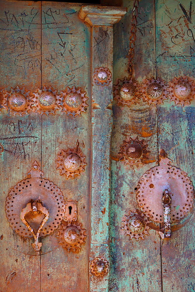Male (right) and female door knockers giving different sounds to ensure the right gender person receives the guest, Abyaneh, Iran, Middle East