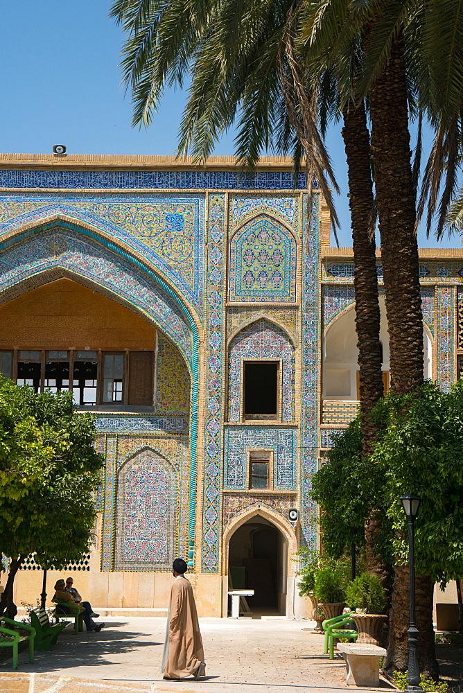 Mullah crossing the courtyard of Madraseh-ye Khan, Shiraz, Iran, Middle East