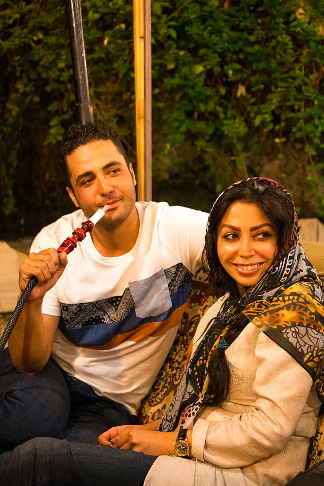 Couple on night out in traditional restaurant, Darband, Northern Tehran, Iran, Middle East