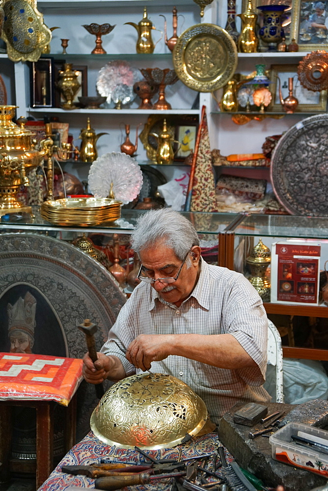 Metalworker,Two bazaaris chatting over the counter of a metalwork shop, Grand Bazaar, Isfahan, Iran, Middle East