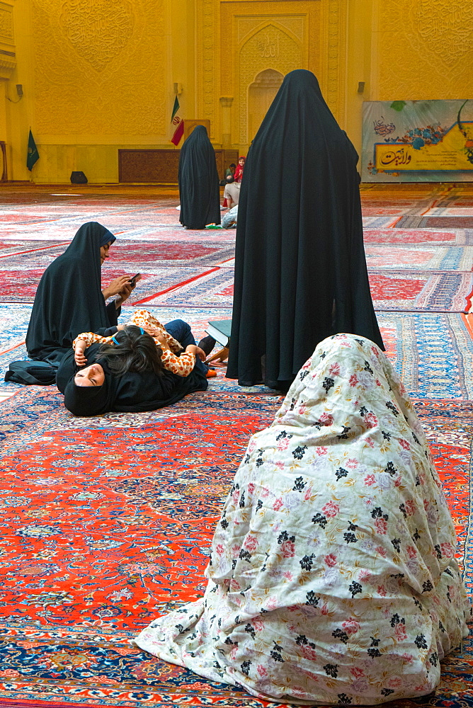 Women and child gathered, interior, Aramgah-e Shah-e Cheragh (Mausoleum of the King of Light), Shiraz, Iran, Middle East