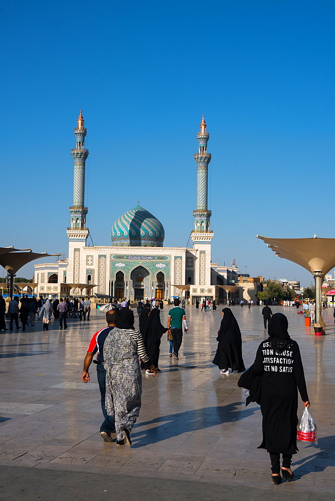 Astane Square in front of the Imam Hassan Mosque, unusually challenging message (Can't Get No Satisfaction) on girl's back, Iran, Middle East