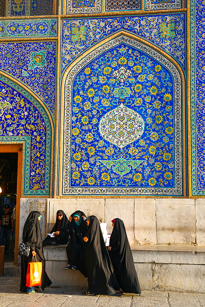 Girls gossiping after shopping in the Grand Bazaar, by entrance of Sheikh Lotfollah Mosque, Isfahan, Iran, Middle East