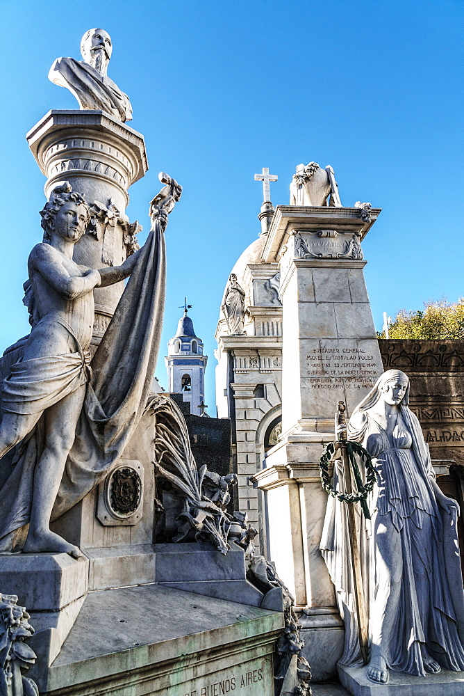 Statues at the entrance to vaults in La Recoleta Cemetery, which lies right in the heart of the city, Buenos Aires, Argentina, South America