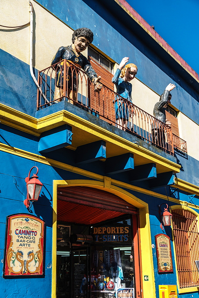 Balcony over bar on El Caminito with statues of Maradona, Evita and Gardel, a tango singer, La Boca, Buenos Aires, Argentina, South America - 450-4248