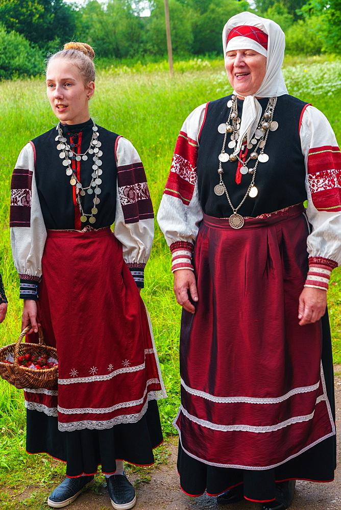 Seto mother and daughter, singing polyphonically at a Feast Day, Uusvada, Setomaa, SE Estonia, Europe - 450-4274