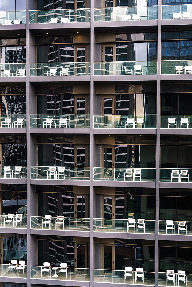 Uniform and soulless apartment blocks with two empty white chairs on each balcony, Manila, Philippines, Southeast Asia, Asia