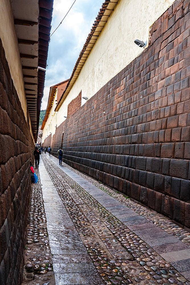 Long view of the precision-built, mortar-less Incan masonry of Loreto Street, Cusco, UNESCO World Heritage Site, Peru