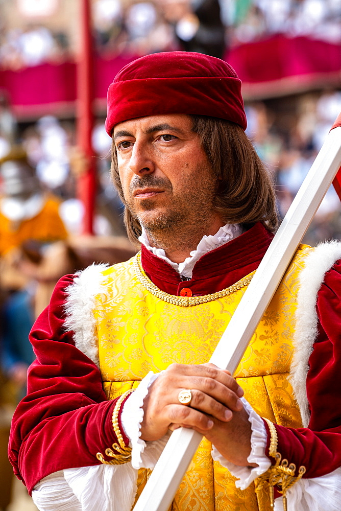 At the pageant that precedes the Palio race, representatives of each neighbourhood parade in traditional costume, Siena, Tuscany, Italy, Europe - 450-4423